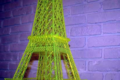 Green fluorescent plexiglass acrylic scroll saw model of the Eiffel Tower