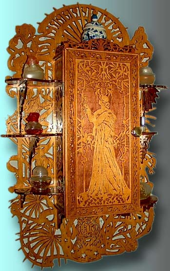 art nouveau wall cabinet in scroll saw fretwork wood with a lady in a...