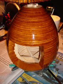 egg part of the fretwork clock formed with wood slides of plywood