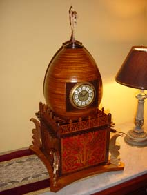scroll saw fretwork egg clock by a table lamp with a black shade