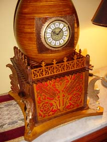 fretwork egg clock with red felt and four golden wingeg sphinxs