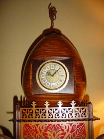 scroll saw egg clock with red felt in the fretwork sides