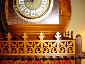 fretworked wooden fence around the scroll saw egg clock