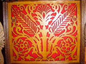 fretwork with red felt in the base of the egg clock