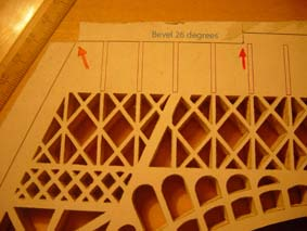 marks to guide the cutting of pieces in the scroll saw wooden model of the Eiffel Tower