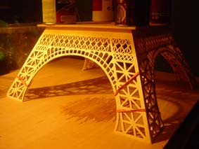 first section of the Eiffel Tower wooden model held with elastic bands