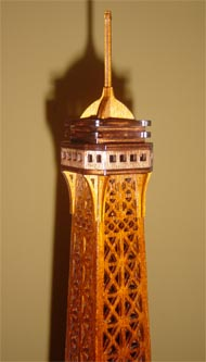 upper part of the scroll saw fretwork wooden model of the Eiffel Tower