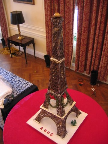 Cake Eiffel Tower model on table dressed in red
