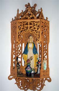 fretwork wooden hanging chapel with virgin mary and adornments
