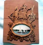 wooden mirror with a ship