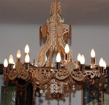 wooden scroll saw fretwork chandelier with grotesques
