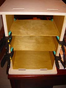 interior of the wooden scroll saw security box during mounting