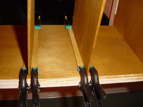 security box shelves drying in position held with clamps