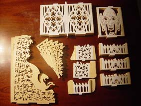 scrolled fretwork pieces of the sun clock on a table