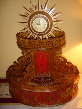 scroll saw fretwork sun clock with a golden clock insert and red felt